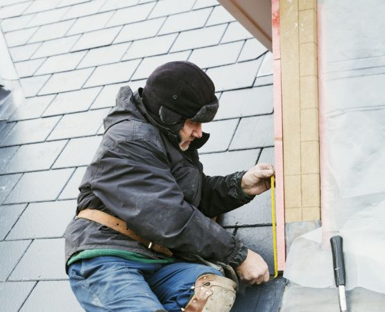 a man fixing shingles