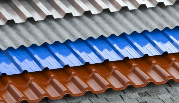 multiple coloured metal shingles stacked on an old roof with mismatched shingles